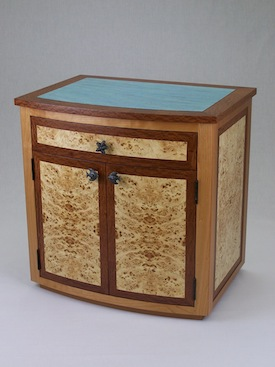 Bow front veneer chest